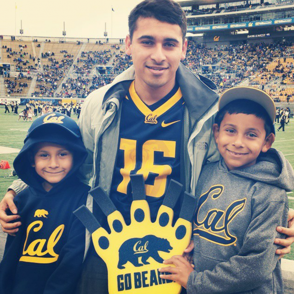 Arturo Fernandez, Ph.D. student at UC Berkeley, stands with his younger brothers at a Cal football game. Photo courtesy of Arturo Fernandez.